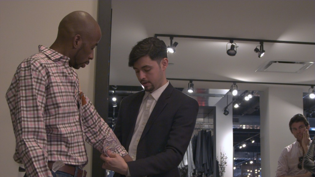 David Butler Tries on a New Shirt at Rothman's